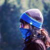 A woman wears a protective face covering and glasses to ward off coronavirus infection