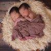 Two twin babies sleeping.