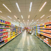 A supermarket aisle empty of people.