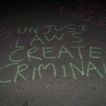 Unjust laws create criminals graffiti
