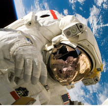 Astronaut spacewalking above Earth