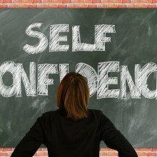 Self confidence written on a blackboard