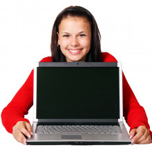 young person with a computer