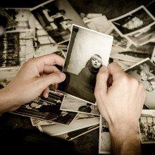 Man looking at photos