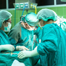 Surgery taking place in an operating theatre