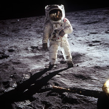 An astronaut standing on the Moon's surface