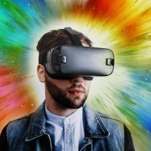 A gamer wearing a virtual reality headset.