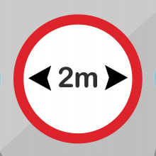 Sign indicating people should keep 2 metres apart.