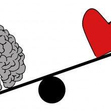 A cartoon brain outweighing a cartoon heart on a balance scale.
