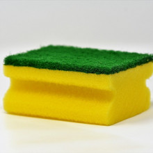 A green and yellow dish sponge