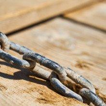 A chain running across a wooden deck.
