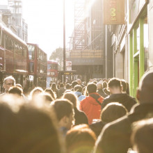 A crowd on a busy London street.