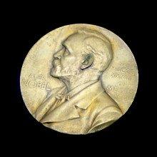 A Nobel Prize medal on a black background.