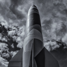 a greyscale image of a large rocket