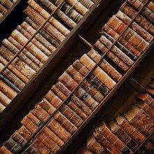 Old books packed on bookshelves