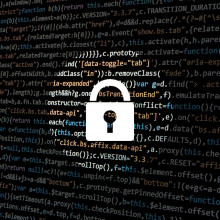 A padlock imposed over a screen of computer code