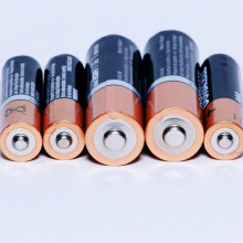 A row of double and triple A batteries.