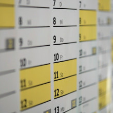 A close up of a wall calendar