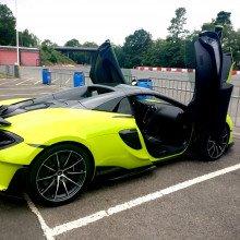 McLaren 600LT Spider parked on a racetrack with the doors open