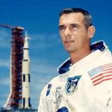 Astronaut Gene Cernan in front of a rocket