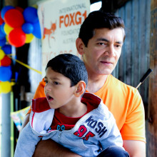 Kushagra Singha, a child with FOXG1 Syndrome, with his father Vivek.