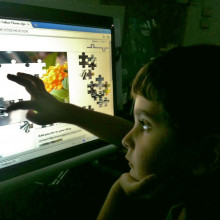 Child using touch screen device