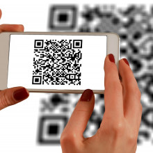 QR code being read by phone in hands