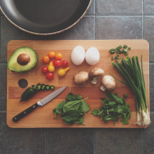 this is a picture of a chopping board full of vegetables