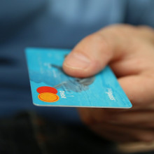 Person holding a blue bank card