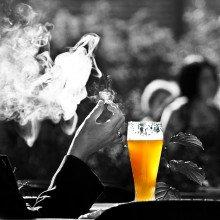 A smoker enjoying a pint of beer
