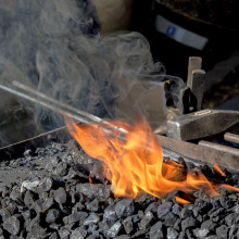 Sword sitting in a forge's embers