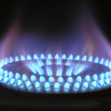 A Close up of a lit gas burner cooker