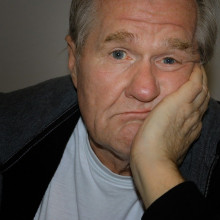 photo of a man looking bored
