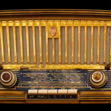 A vintage brown and gold tube radio,