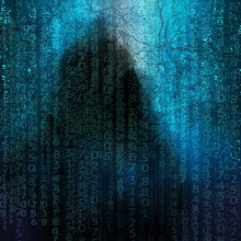 Lines of matrix-style green characters obscuring a hooded figure.