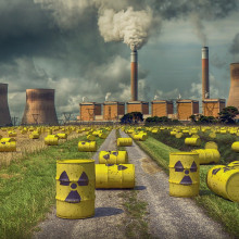 Yellow barrels of nuclear waste photoshopped in front of a nuclear power plant