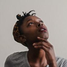 Woman looking up in thought