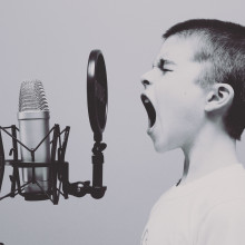 Child shouting into microphone