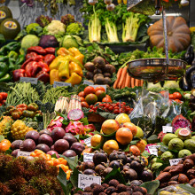 A food market with a wide array of different vegetables.