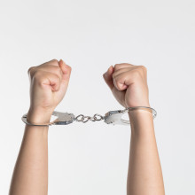 Hands in the air that have been cuffed