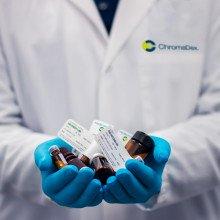 Drug bottles held in a doctor's hand