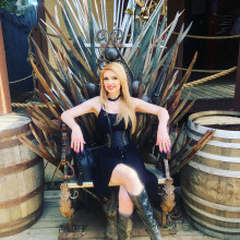 A woman sitting on the iron throne