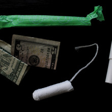 photograph of a tampon and some dollars