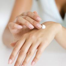 Drop of moisturiser on hand