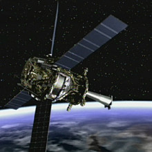 Artist concept of Gravity Probe B spacecraft in orbit around the Earth.
