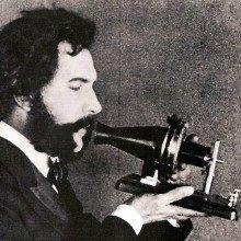 Alexander Graham Bell speaking into a prototype telephone