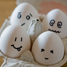 Eggs in an egg box, with faces
