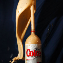A Coke bottle erupting when Mentos are added