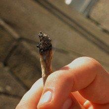 Person smoking a marijuana (cannabis) joint