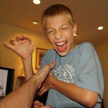 Boy being tickled
